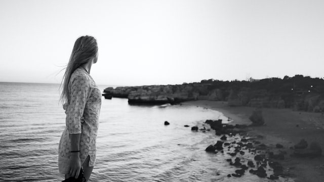Photo of woman standing on shore